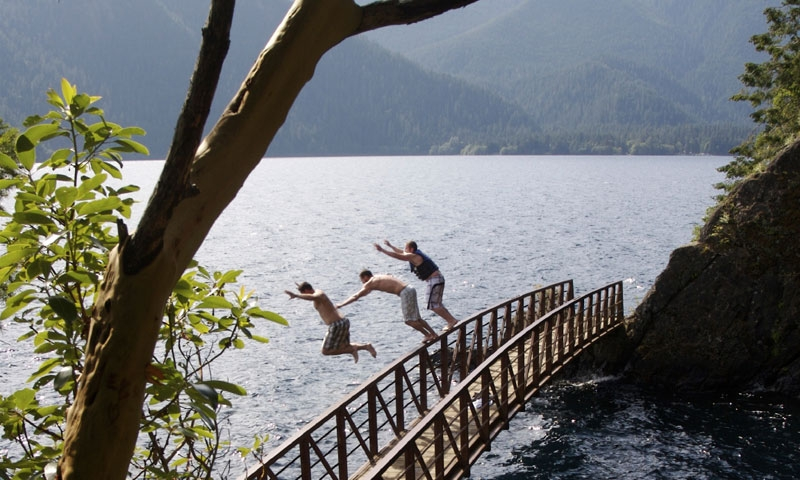 Jumping off a bridge at Lake Crescent in Olympic National Park